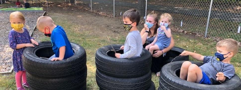 prek kids in tires.jpg